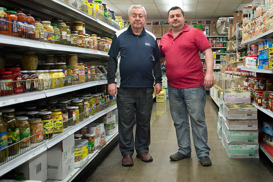 Eugene Titov, his son Paul, and the rest of the Titov family has lived and worked in the Lansing area for 27 years. They own and operate American International Bulk Food on South Pennsylvania Avenue.