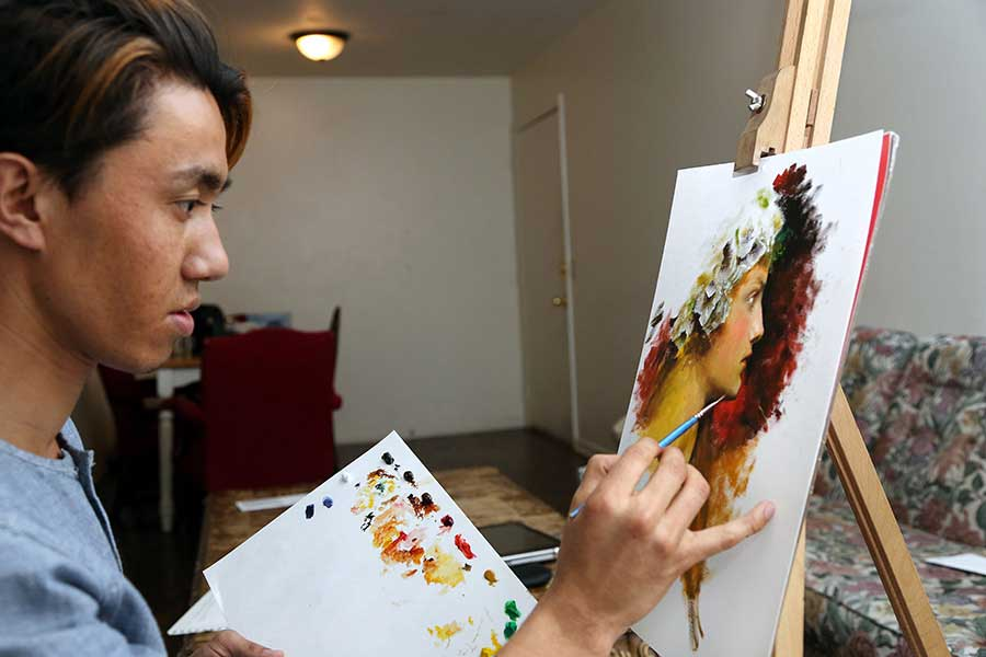 Raz draws or sketches every day in the sparse south Lansing apartment he shares with three other Afghan refugees.